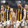Dejected Hawks players after their loss to Collingwood on Friday night.