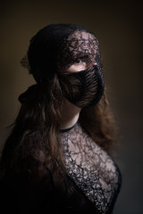 Gwendolynne Burkin in one of her other French lace masks.