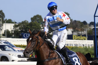 Tommy Berry punches the air as Stay Inside wins the Golden Slipper.