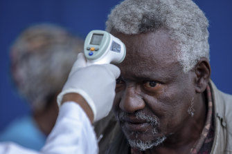 A man at the Zewditu Memorial Hospital in the Ethiopian capital of Addis Ababa has his temperature checked.