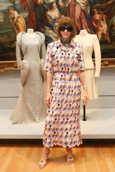 US Vogue editor Anna Wintour with the two Chanel pieces from her personal collection she has donated to the National Gallery of Victoria.