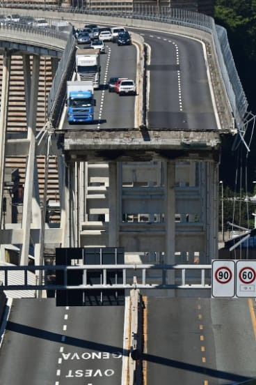 Vehicles are blocked on the collapsed Morandi highway bridge in Genoa, Italy.