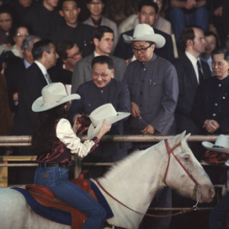 Deng Xiaoping receives a stetson hat at a Houston rodeo during a visit in 1979.