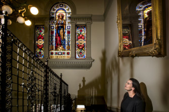 Roxanne Macara admires the historic window panels designed by French artist Lucien Henry, due for restoration.