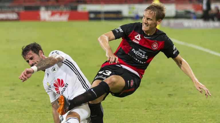 Old hand: Michael Thwaite clears for the Wanderers under pressure from Thomas Doyle of the Phoenix.