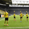 Dortmund run riot as Bundesliga returns