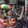 Women hold a portrait of deposed Myanmar leader Aung San Suu Kyi, during an anti-coup demonstration in Mandalay, Myanmar, Friday, March 5, 2021. Protests continue in Myanmar against the Feb 1 military coup that ousted the civilian government of Aung San Suu Kyi. Despite daily operations by police to disperse the crowds, defiant protesters continue to return to the streets in parts of the country.