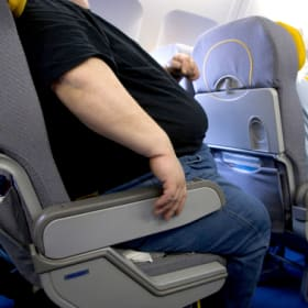 Passenger sues airline after being seated next to obese man