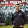 Chris Johnson in front of a mural, which features his grandmother, at Thornbury's Aborigines Advancement League.