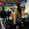 Western Sydney residents shop for groceries as the number of coronavirus cases in their city continues to grow.