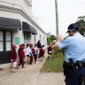 Ten more NSW schools evacuated after email threats