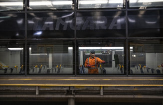 A Sydney trains cleaner on a Tangara at Mortdale Depot.