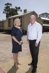 Deputy principal Kim Cootes and principal David Smith in the playground of Sydney's Fairfield Public School.
