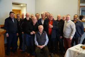 Bryan Harding, seated, surrounded by friends and former colleagues at a celebration at Hogan's Hotel in Wallan last week. Harding has written a book detailing his time with Victoria Police, including as leader of the police union.