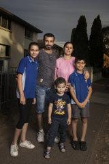 Bassam and Raya Mansoor with children Muhabah, 13, Marinos, 4, and Minas, 10.