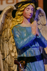 An angel with a holster watches over diners at the Winter Feast.
