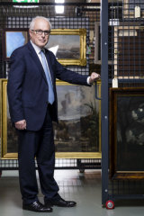 State Librarian Dr John Vallance with some of the 300 valuable paintings that are about to go on display in October.