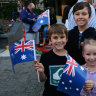 Excited attendees wave their flags at the Anzac Day Parade.