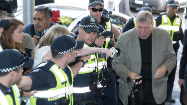 Cardinal George Pell arrives for the second day of his committal hearing.