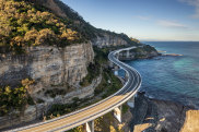 Lawrence Hargrave Drive twists through coastal villages north of Wollongong, skittering out over the ocean at Sea Cliff Bridge.