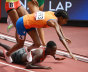 Dutchwoman Sifan Hassan trips during the 1500m heats, but gets back up.