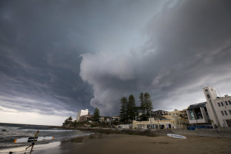 A storm rolls into Cronulla beach, where the Reserve Bank expects climate change is