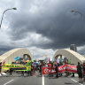 Activists end week of climate protests by shutting down Brisbane bridge