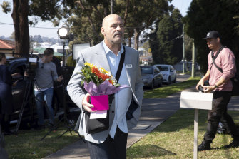 A chaplain arrives at the home of Sydney stabbing suspect Mert Ney.