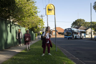 A student waits for her bus in Willoughby on Friday, May 8.