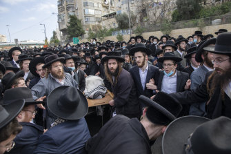 Ultra-Orthodox Jews carry the body of prominent rabbi Meshulam Soloveitchik during his funeral in Jerusalem, on Sunday, January 31.