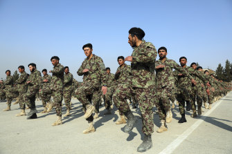 Afghan National Army soldiers march at their graduation ceremony in January.