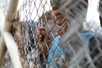 A child at the fence at al-Hawl camp in Syria. The camp houses the wives and children of former Islamic State fighters.