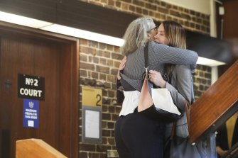 Hannah Quinn (right) arrives at the Supreme Court in Darlinghurst for the sentencing hearing on Friday.