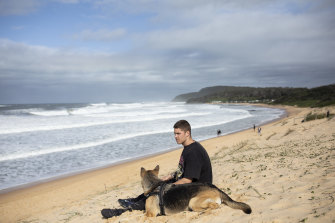 Corbin Dal Walters with his dog Stormy at his favourite surf spot at Shelley beach the day prior to his  Enlistment Ceremony.