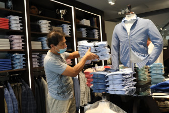 An employee of the Spada clothing store in Rome preparing for Monday's reopening. Italy was the first country to impose a nationwide lockdown to stem the flow of coronavirus.
