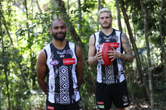Collingwood's Travis Varcoe and Jack Crisp showcase their Indigenous round guernsey.