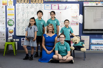 Principal Melanie Macmillan with students at Warwick Farm Public School, which is exceeding expectations in its results.