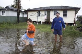 Danny Sondermeyer and son Harrison are nervously eyeing the rising river.