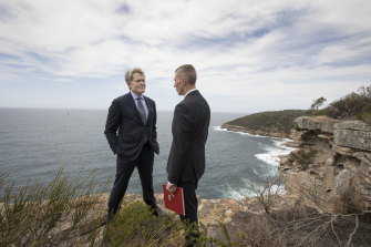 Steve Johnson, left, and Detective Chief Inspector Peter Yeomans in 2018 on the cliff at North Head, the site of Scott Johnson's death.