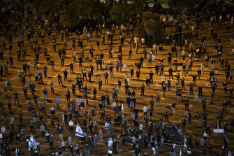 People keep social distancing during a protest against Prime Minister Benjamin Netanyahu in Tel Aviv.
