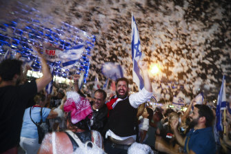 Israelis celebrate the swearing in of the new government in Tel Aviv.