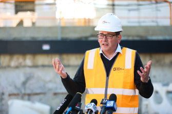 Lock out, not down: Premier Daniel Andrews wants to reduce international arrivals by at least 75 per cent.
