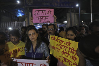 Indians outside Tihar central prison show their support for the execution of four men.