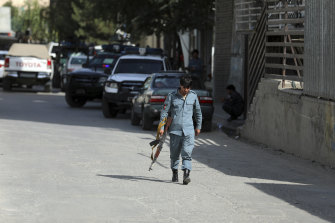 Afghan security personnel arrive at the scene of the fatal shooting of media chief Dawa Khan Menapal.