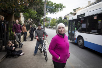 Glebe resident Di Anstey (front) and her neighbours say a pop-up cycleway on Bridge Road makes life more difficult for them.