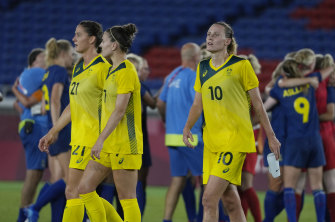 Laura Brock, Steph Catley and Emily van Egmond depart the field after Australia's loss to Sweden.