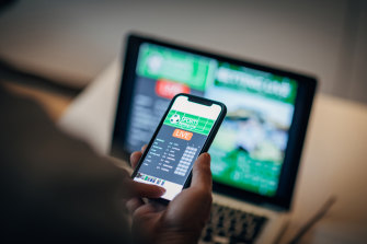 """Federal Parliament is considering an overhaul of gambling laws to ban punters from using credit cards or """"digital wallets"""" for online gambling in Australia."""