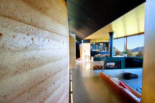 The Mystery Bay's houses rammed earth walls are longer than an Olympic pool and nearly a metre wide in some spots.