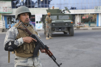 Afghan soldiers stand guard near a polling station in Kabul.