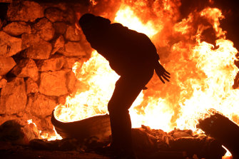 Palestinians burn tires in response to Israeli forces intervention in a rally marking the 73rd anniversary of the Nakba Day.